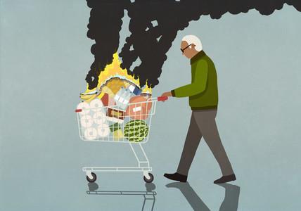Senior man pushing shopping cart full of burning groceries