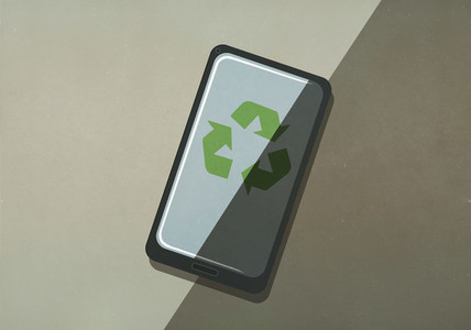 Green recycling symbol on smart phone screen