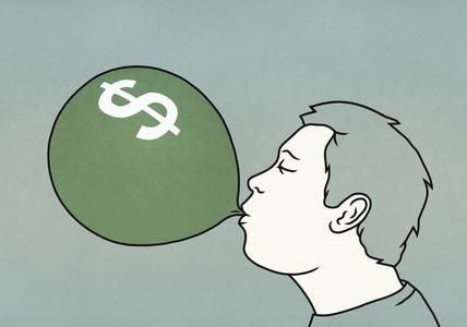 Man inflating dollar sign balloon