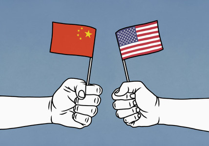 Hands clenching Chinese and American flags on blue background