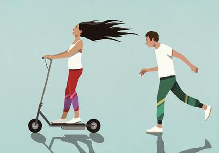 Boyfriend running behind carefree girlfriend on electric scooter