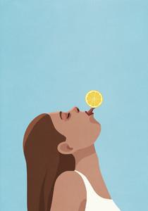 Playful young woman balancing lemon on tongue