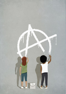 Girls painting anarchism symbol on gray wall