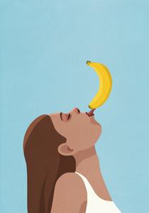 Playful woman balancing banana on tongue on blue background