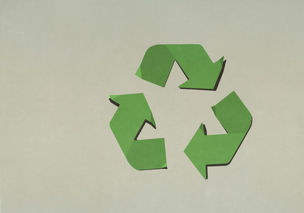 Green recycling symbol on brown background