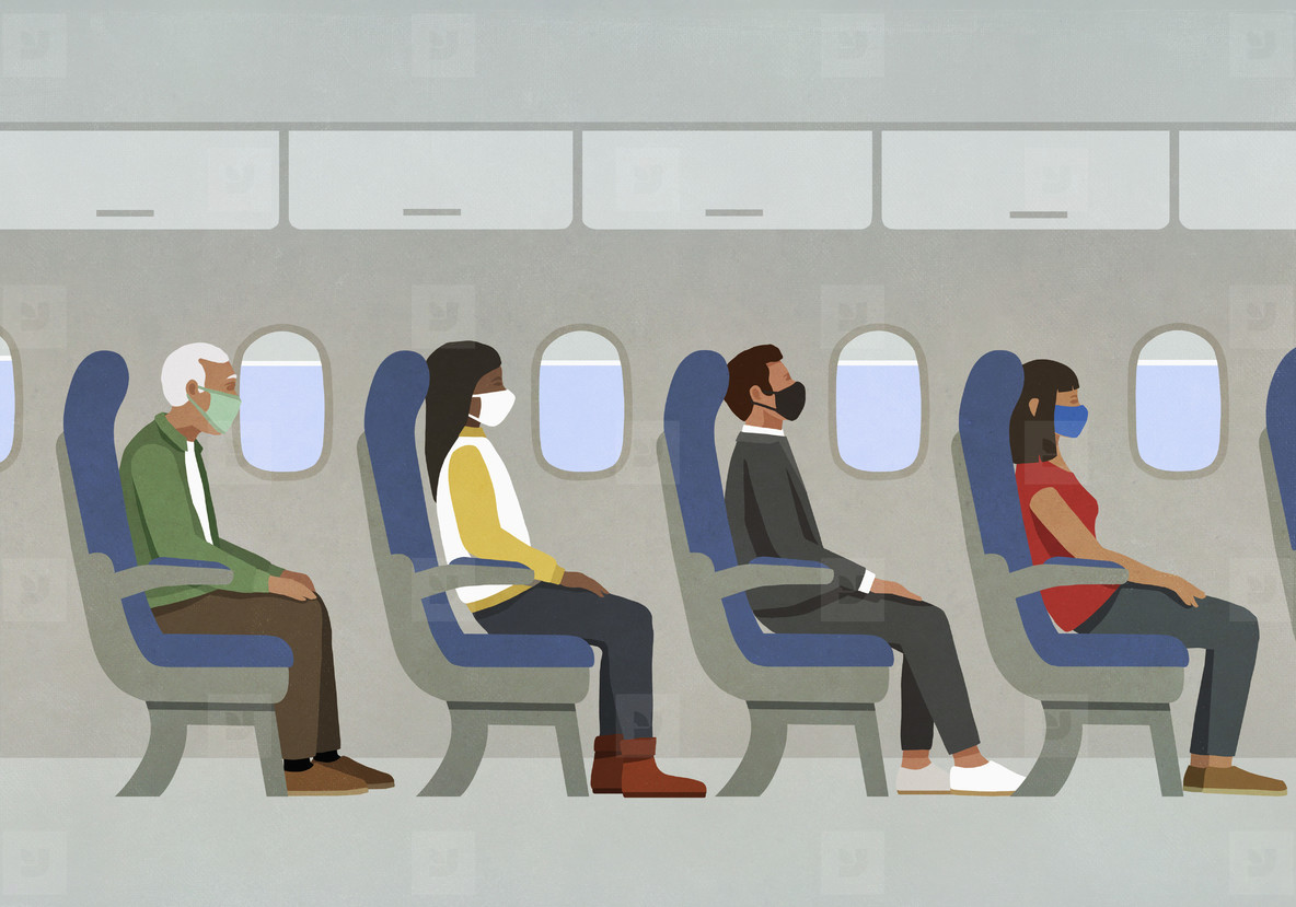 Passengers in face masks riding in airplane