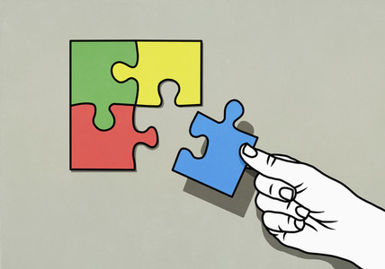 Hand completing puzzle with missing piece