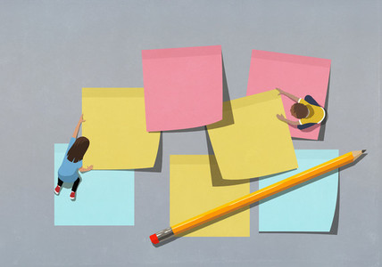 Schoolchildren arranging large multicolor adhesive notes