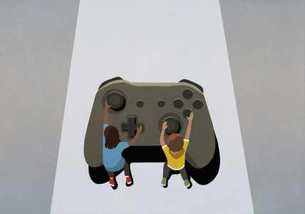 Boy and girl playing at large video game controller