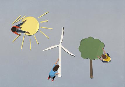 Kids arranging environment and wind turbine paper symbols