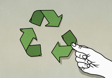 Hand arranging green recycling arrow symbol