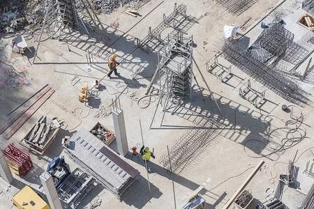 Aerial view construction workers working at sunny construction site