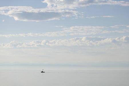 Boat on sunny idyllic blue Lake Constance