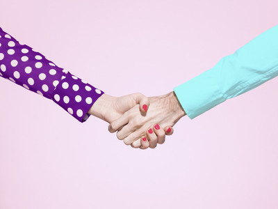 Vibrant handshake on pink background