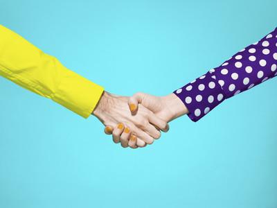 Vibrant handshake on turquoise background