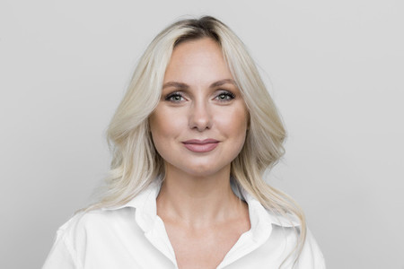 Portrait confident beautiful blonde woman