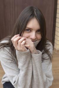 Portrait beautiful young brunette woman in turtleneck sweater