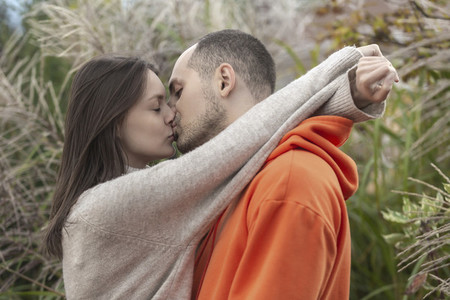 Sensual with affectionate young couple kissing