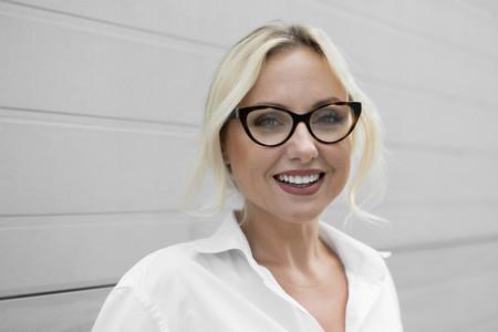 Portrait happy with beautiful businesswoman in eyeglasses