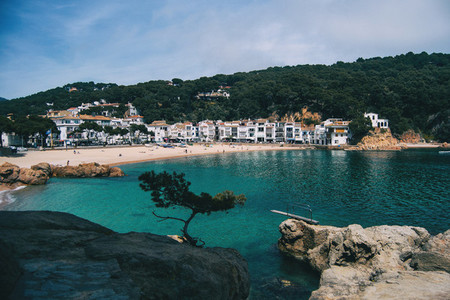 Beach in a town on the Costa Brava Catalonia Spain has a trampoline