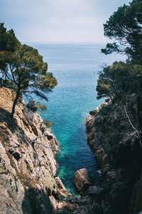 small cove with crystal clear water on the costa brava  catalonia  spain