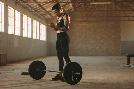 Fit woman about to start barbell workout