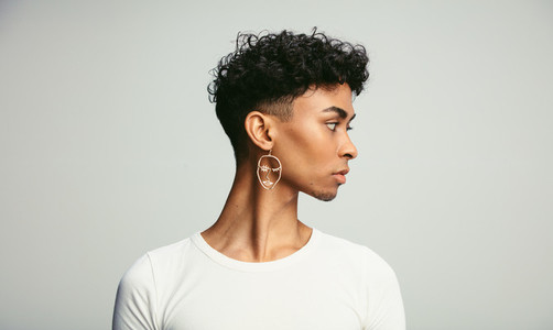 Androgynous male with earring
