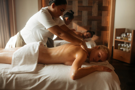 Women getting massage at a spa