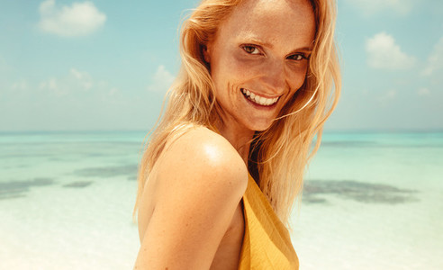 Portrait of freckled woman at a beach