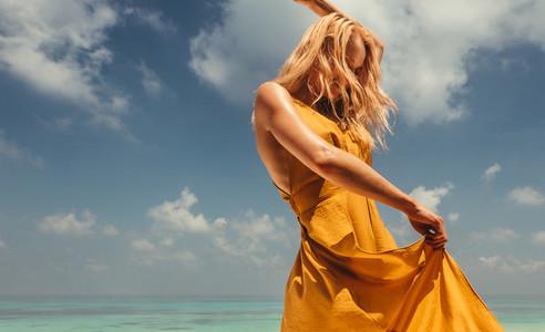 Beautiful woman dacning on the beach