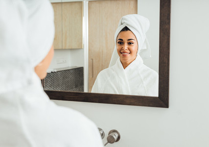 Woman in bathrobe looking