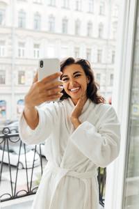 Happy woman taking selfie