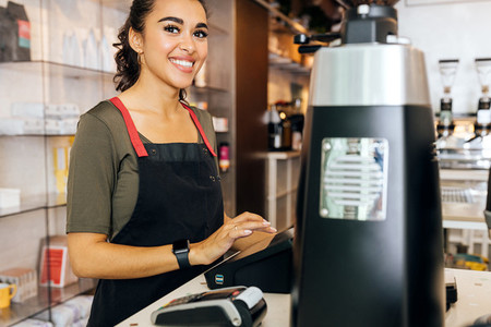 Young beautiful barista standing