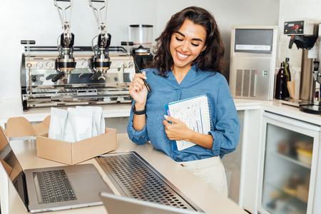 Smiling entrepreneur woman stand