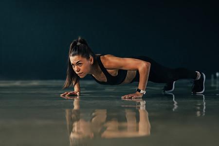 Strong woman doing push ups