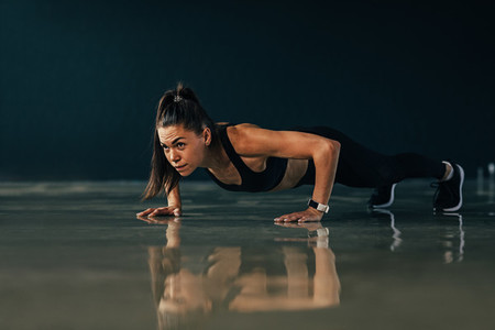 Strong woman doing push ups