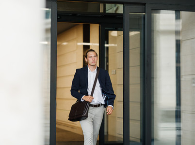 Male entrepreneur exiting from