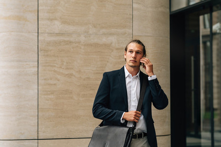 Businessman with crossbody bag
