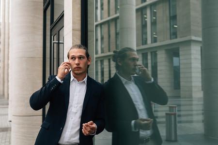 Businessman talking over smart