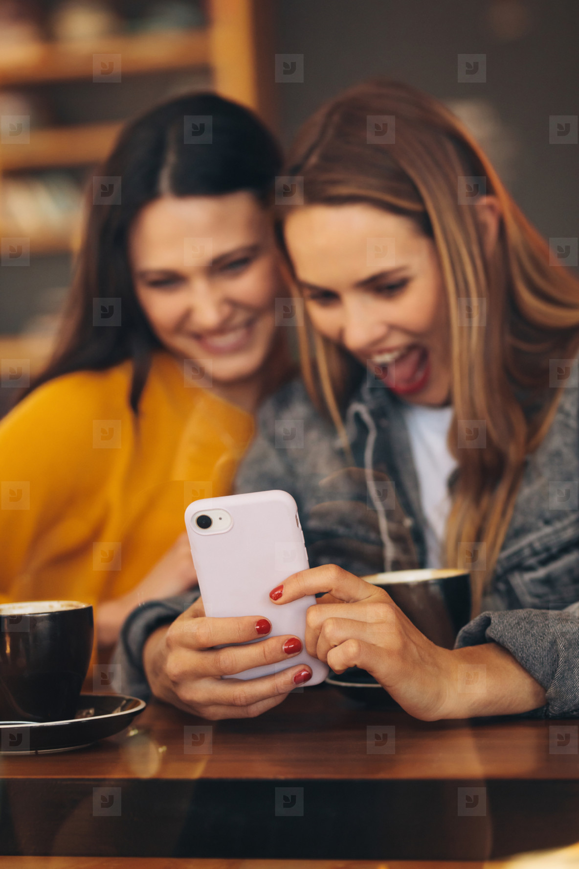 Friends looking funny updates on mobile phone