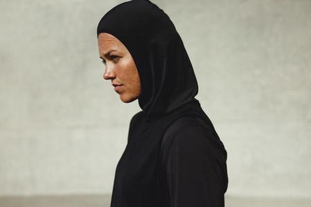 Muslim woman in sportswear outdoors