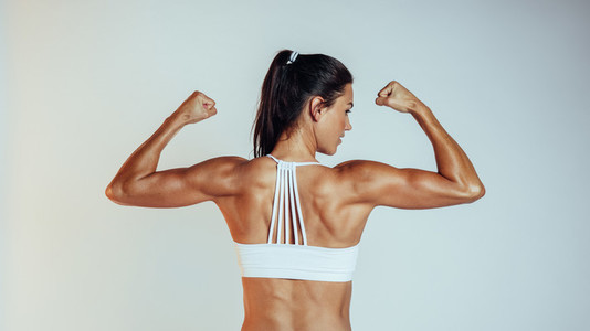 Portrait of muscular fitness woman