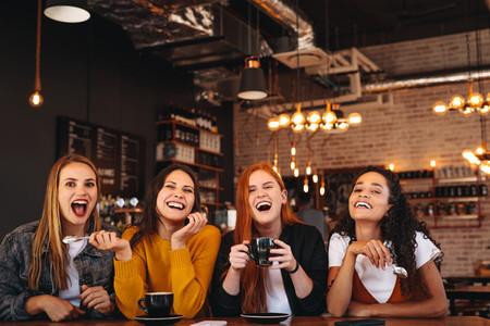 Female friends enjoying a weekend at a coffee house