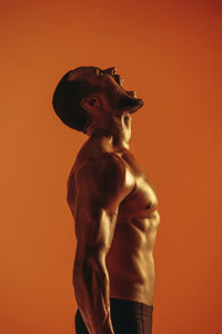Side view portrait of muscular athlete shouting