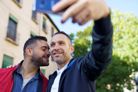 Gay couple making a selfie with their smartphone