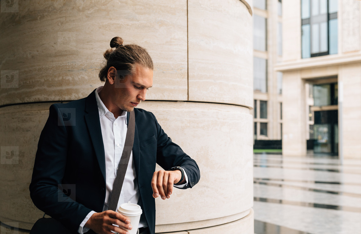 Young businessman looking
