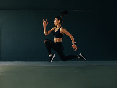 Side view of a woman jumping