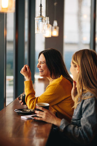 Women smiling in a coffee shop