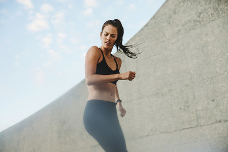 Woman exercising outdoors in morning