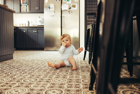 Cute baby eating at home